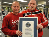 Guelph weightlifter Walter Urban (left) and his coach Mark Giffin display the certificate Urban was awarded for setting a Guinness world record on Live! with Regis and Kelly Thursday. Urban squat lifted a total of 127,245 pounds in an hour for the record. Rob Massey/Guelph Mercury